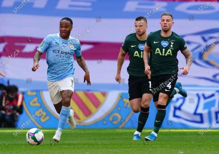 Raheem Sterling of Manchester City runs away from Toby Alderweireld and Eric Dier of Tottenham Hotspur