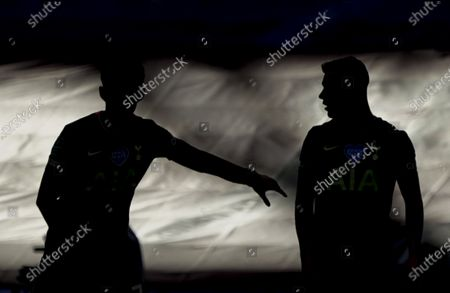 Son Heung-Min, left, and Giovani Lo Celso of Tottenham Hotspur in silhouette