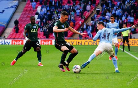 Phil Foden of Manchester City battles with Giovani Lo Celso of Tottenham Hotspur