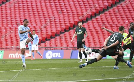 Raheem Sterling of Manchester City gets a shot on goal as Eric Dier of Tottenham Hotspur tries to block