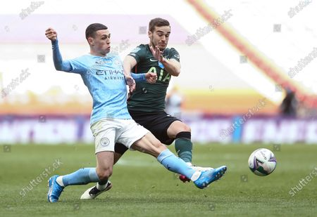 Harry Winks of Tottenham Hotspur tackles Phil Foden of Manchester City