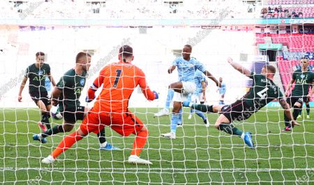 Raheem Sterling of Manchester City  shot on goal is blocked by Eric Dier of Tottenham Hotspur