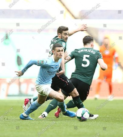 Stock Picture of Phil Foden of Manchester City  avoids Harry Winks and Pierre Hojbjerg of Tottenham Hotspur