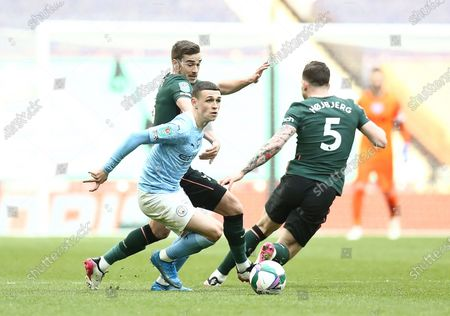 Stock Photo of Phil Foden of Manchester City  avoids Harry Winks and Pierre Hojbjerg of Tottenham Hotspur