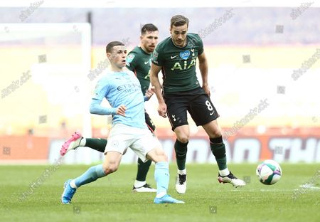 Stock Image of Phil Foden of Manchester City  and Harry Winks of Tottenham Hotspur