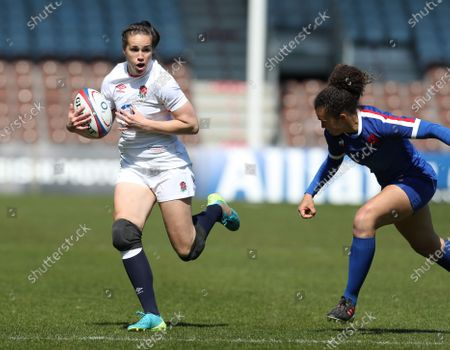 Emily Scarratt of England tackled by Caroline Drouin of France