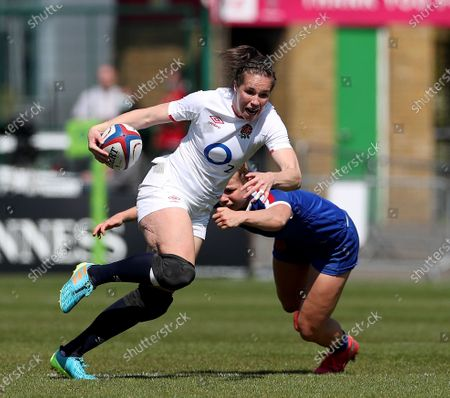 Stock Photo of Emily Scarratt of England gets past Romane Menager of France