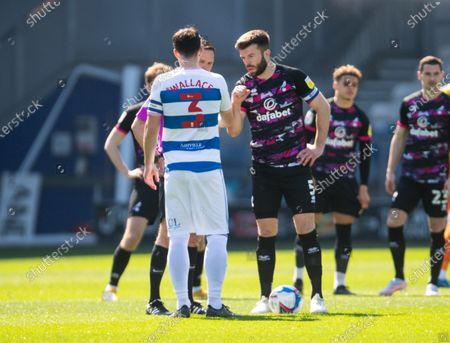 Lee Wallace of QPR and Grant Hanley of Norwich City during the coin toss