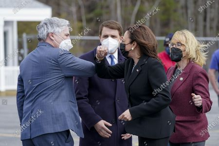 Vice President Kamala Harris is greeted by Andrew Hosmer, Mayor of Laconia, left, Sen. Maggie Hassan, D-N.H., right, and Rep. Chris Pappas, D-N.H., second from left, at Laconia Municipal Airport in Gilford, N.H., on arrival to New Hampshire
