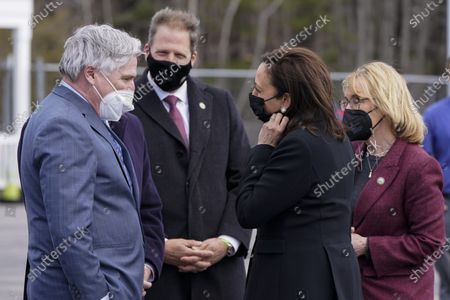 Vice President Kamala Harris is greeted by Andrew Hosmer, Mayor of Laconia, left, Sen. Maggie Hassan, D-N.H., right, Rep. Chris Pappas, D-N.H., obscured second from left, and New Hampshire Gov. Chris Sununu, center, at Laconia Municipal Airport in Gilford, N.H., on arrival to New Hampshire