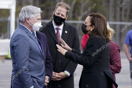Vice President Kamala Harris is greeted by Andrew Hosmer, Mayor of Laconia, left, Sen. Maggie Hassan, D-N.H., obscured right, Rep. Chris Pappas, D-N.H., obscured second from left, and New Hampshire Gov. Chris Sununu, center, at Laconia Municipal Airport in Gilford, N.H., on arrival to New Hampshire