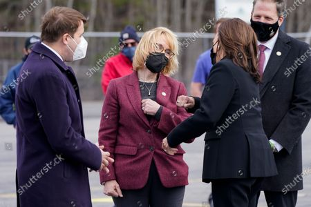 Vice President Kamala Harris is greeted by Sen. Maggie Hassan, D-N.H., second from left, Rep. Chris Pappas, D-N.H., left, and New Hampshire Gov. Chris Sununu, right, at Laconia Municipal Airport in Gilford, N.H., on arrival to New Hampshire