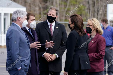 Vice President Kamala Harris is greeted by Andrew Hosmer, Mayor of Laconia, left, Sen. Maggie Hassan, D-N.H., right, Rep. Chris Pappas, D-N.H., second from left, and New Hampshire Gov. Chris Sununu, center, at Laconia Municipal Airport in Gilford, N.H., on arrival to New Hampshire