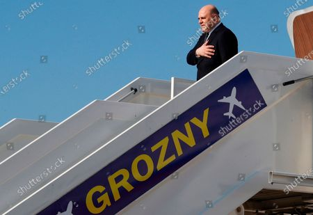 Russian Prime Minister Mikhail Mishustin steps down from the plane upon his arriving at an airport outside the Chechen capital of Grozny, Russia, . During his visit Mishustin has to meet with Chechnya's regional leader Ramzan Kadyrov