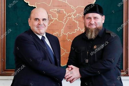 Russian Prime Minister Mikhail Mishustin, left, and Chechnya's regional leader Ramzan Kadyrov greet each other during their meeting in the Chechen capital of Grozny, Russia
