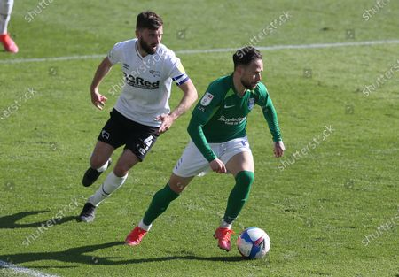 Birmingham's Ivan Sanchez turns away from Derby County's Graham Shinnie