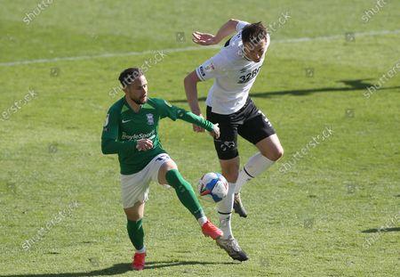 Derby County's Craig Forsyth battles with Birmingham's Ivan Sanchez