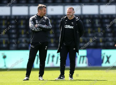 Derby County manager Wayne Rooney shares a pre match chat with coach Shay Given