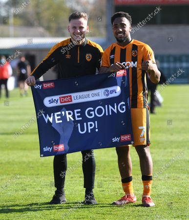 James Scott and Mallik Wilks of Hull City celebrate at full time