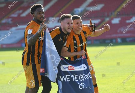 Stock Picture of Mallik Wilks, James Scott and Greg Docherty of Hull City celebrate at full time