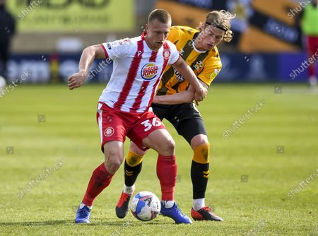 Stock Photo of Luke Norris of Stevenage holds off Declan Drysdale of Cambridge United