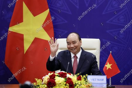 Vietnamese President Nguyen Xuan Phuc smiles as he attends the virtual Leaders summit on climate in Hanoi, Vietnam, 23 April 2021. The summit which is hosted by the US from 22 to 23 April.