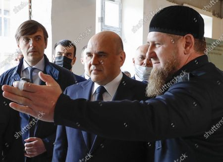 Russian Prime Minister Mikhail Mishustin (2-R) and the Chechen Republic Head Ramzan Kadyrov (R)  inspect the construction site of a secondary boarding school for children with mental development issues, in the village of Staraya Sunzha near Grozny, the Chechen Republic, Russia, 23 April 2021.