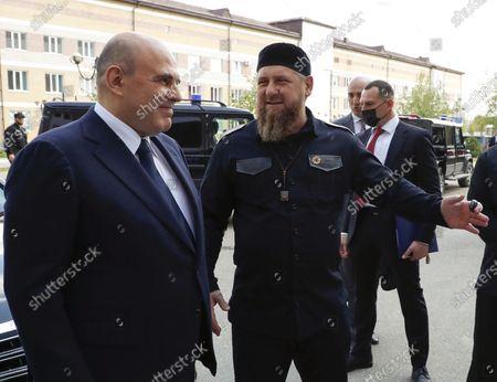 Russian Prime Minister Mikhail Mishustin (L) and Head of the Chechen Head Ramzan Kadyrov (front R)  inspect the republic's perinatal center in Grozny, the Chechen Republic, Russia, 23 April 2021.