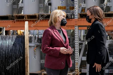 Vice President Kamala Harris speaks with Sen. Maggie Hassan, D-N.H., as she arrives to the New Hampshire Electric Co-Op (NHEC), in Plymouth, N.H