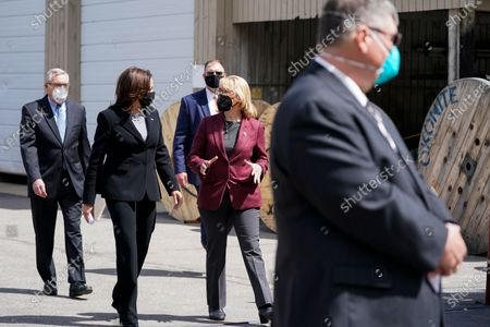 Vice President Kamala Harris speaks with Sen. Maggie Hassan, D-N.H., as she arrives at the New Hampshire Electric Co-Op (NHEC), in Plymouth, N.H