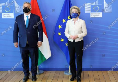 Hungarian Prime Minister Viktor Orban, left, is greeted by European Commission President Ursula von der Leyen prior to a meeting at EU headquarters in Brussels