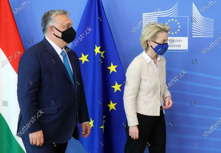 Hungarian Prime Minister Viktor Orban, left, walks with European Commission President Ursula von der Leyen prior to a meeting at EU headquarters in Brussels