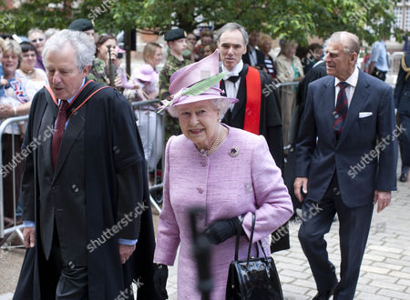 Queen Elizabeth II and Prince Philip walk into the college with the Provost William Waldegrave