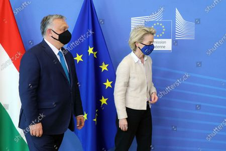 Hungarian Prime Minister Viktor Orban (L) is welcomed by European Commission President Ursula von der Leyen in the Berlaymont building at the EU headquarters in Brussels, Belgium, 23 April 2021.