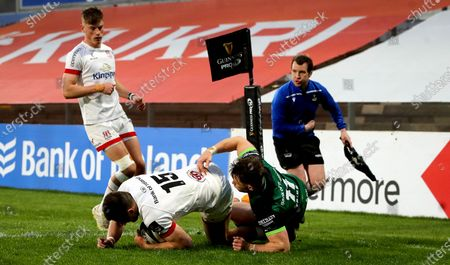 Ulster vs Connacht. Ulster's Jacob Stockdale scores a try despite Matt Healy of Connacht
