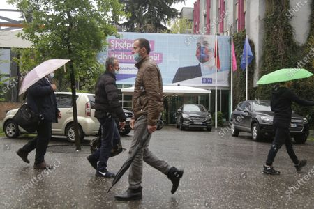 People walk past an election banner showing Socialist Party leader Edi Rama in Tirana, Albania, 23 April 2021. Albania is holding general elections on 25 April 2021, with centre-left sitting Prime Minister Edi Rama's Socialist Party running for a third mandate, and facing a challenge from a dozen parties united behind the main opposition Democratic Party.