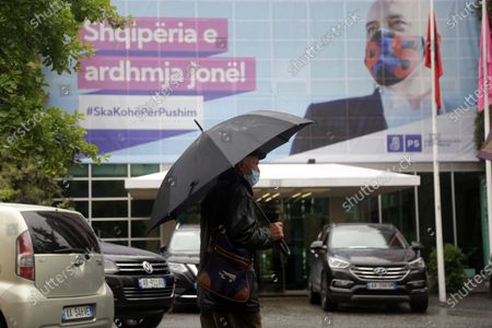 A man walks past an election banner showing Socialist Party leader Edi Rama in Tirana, Albania, 23 April 2021. Albania is holding general elections on 25 April 2021, with centre-left sitting Prime Minister Edi Rama's Socialist Party running for a third mandate, and facing a challenge from a dozen parties united behind the main opposition Democratic Party.