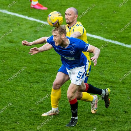 Filip Helander of Rangers heads from Chris Kane of St Johnstone during the Scottish Cup quarter final match at Ibrox Stadium, Glasgow.