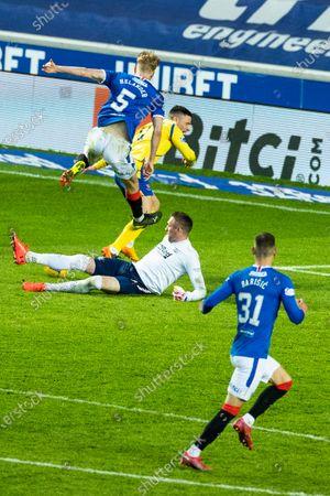Rangers goalkeeper Allan McGregor saves from Michael O'Halloran of St Johnstone as team mate Filip Helander gets injured during the Scottish Cup quarter final match at Ibrox Stadium, Glasgow.