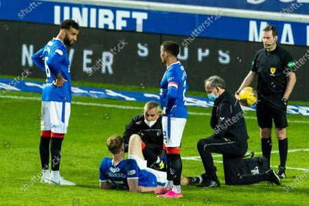 Filip Helander of Rangers gets treatment during the Scottish Cup quarter final match at Ibrox Stadium, Glasgow.