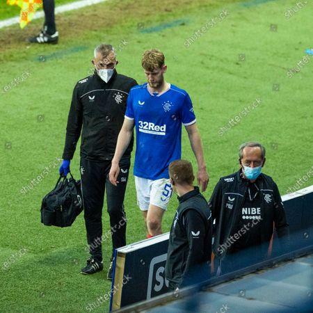 Filip Helander of Rangers goes off injured during the Scottish Cup quarter final match at Ibrox Stadium, Glasgow.