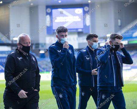 Rangers players Jack Simpson, Ianis Hagi and Scott Wright walk round the pitch before the start of the Scottish Cup quarter final match at Ibrox Stadium, Glasgow.