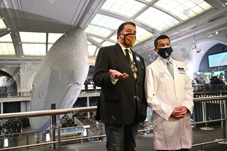 Neil deGrasse Tyson and Dave A. Chokshi, Commissioner of Health of the City of New York, at the American Museum of Natural History during the of the museum's opening as a mass vaccination site in New York.
