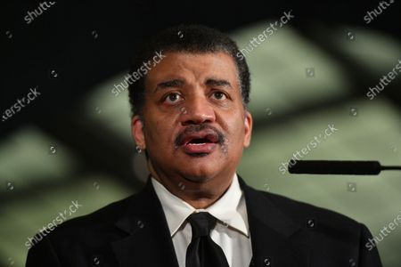 Neil deGrasse Tyson speaks during a press conference at the American Museum of Natural History in New York.