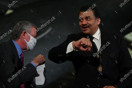 Mayor Bill de Blasio and Neil deGrasse Tyson speak during a press conference at the American Museum of Natural History in New York.