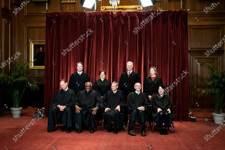 Members of the Supreme Court pose for a group photo at the Supreme Court in Washington, . Seated from left are Associate Justice Samuel Alito, Associate Justice Clarence Thomas, Chief Justice John Roberts, Associate Justice Stephen Breyer and Associate Justice Sonia Sotomayor, Standing from left are Associate Justice Brett Kavanaugh, Associate Justice Elena Kagan, Associate Justice Neil Gorsuch and Associate Justice Amy Coney Barrett