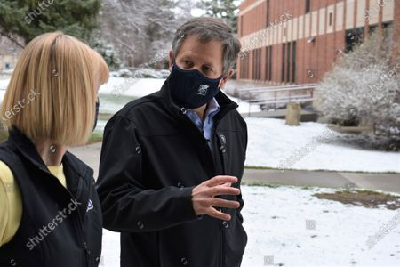 Montana Republican U.S. Sen. Steve Daines, right, speaks with Chancellor Stefani Hicswa on the campus of Montana State University Billings in Billings, Mont., on . Daines says he has concerns with President Joe Biden's pick to lead the U.S. Bureau Land Management, Tracy Stone-Manning, over her ties to groups that aired campaign ads against him in the 2021 election