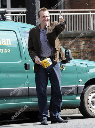 Stock Picture of Christopher Eccleston films the Jimmy McGovern drama 'Accused'. Eccleston plays a plumber in the new BBC drama, he is pictured getting a parking ticket.