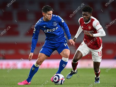 Everton's James Rodriguez, left, duels for the ball with Arsenal's Thomas Partey during the English Premier League soccer match between Arsenal and Everton at the Emirates stadium in London