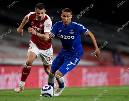 Everton's Richarlison, right, duels for the ball with Arsenal's Granit Xhaka during the English Premier League soccer match between Arsenal and Everton at the Emirates stadium in London